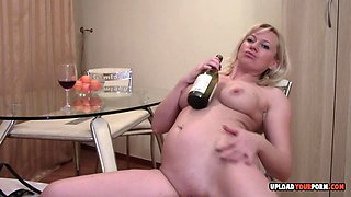 Mature wife gets horny and starts playing with wine bottle