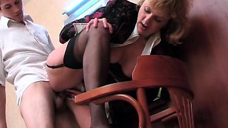 Horny mature lady in stockings gets fucked by a young stud
