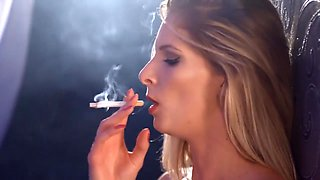 Rebecca is naked and shows her perfect slim body and sexy tits and smokes
