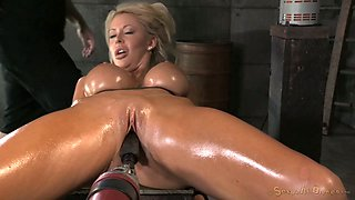 Cuffed to the wooden table oiled tanned blonde gets mouthfucked rough