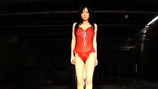 Delightful Asian girl sensually reveals her amazing curves