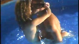 Lusty brunette chick blows hard dick in the pool and gets her pussy licked