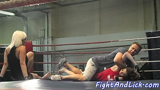 Lesbian beauties wrestling and kissing