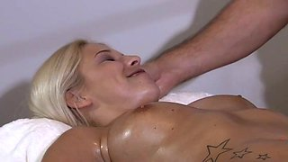 Oiled seductive blonde babe Karol Lilien gets her tits sucked and pussy licked