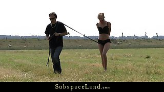 Blonde slave bound and fucked on the field