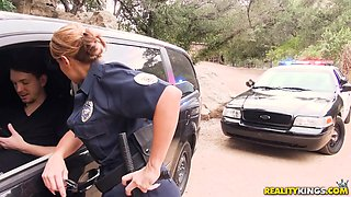 busty police officer gets fucked in the backseat of the car