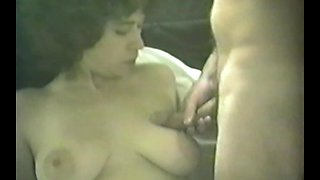 Busty Brunette Swallows a Big Load After Blowing Her Man