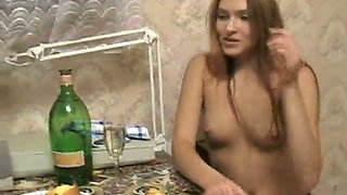 Sweet Russian babe gets topless after a single glass