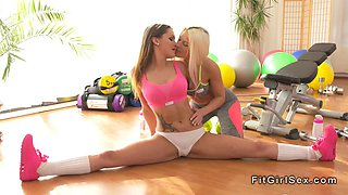 Busty fitness lesbians licking each other