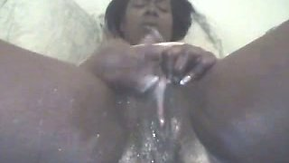 Ugly black webcam slut rubs her clit and tickles pussy madly