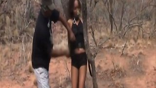 african slave gets abused by two masters outdoors clip