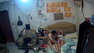 The rented uncle goes to bed with his wife who is playing with her mobile p