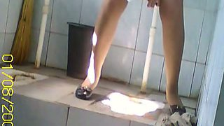 Hidden piss cam shoots Asian in pantyhose peeing in toilet