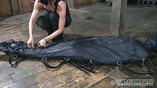 This leather sleep sack is very tight on slave's body