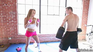 Mia Lelani is a beautiful blonde whos getting ready for a wrestling match