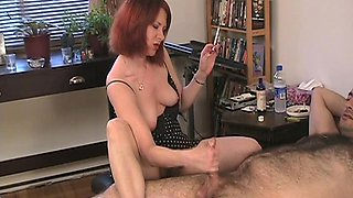 A hot brunette massage a huge cock while smoking