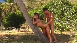 Sizzling hot redhead babe on the beach having passionate sex