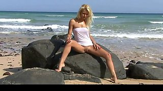 hot blonde teen posing on public beach