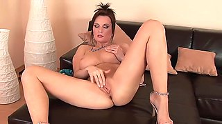 Lucie strips and rubs her clit