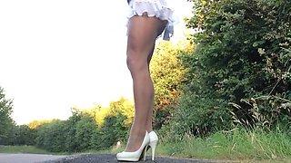 Crossdresser frilly mini skirt pantyhose .