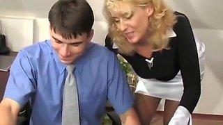 Mature secretary seduces the boss