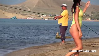 Milf neon green swimsuit shows her body to fisherman