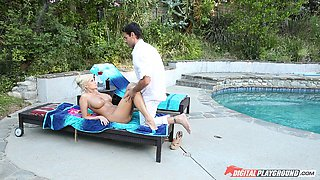 Sublime blonde with large boobs gets an erotic massage by the pool