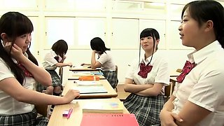 Exciting Oriental schoolgirls engage in wild lesbian action