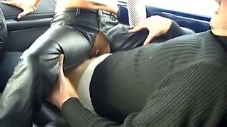 Skanky girl in leather pants fucking in a car