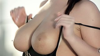 Big titty brunette in sports wear takes it off and fingers herself