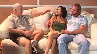Devoted brunette in high heels and miniskirt getting gangbanged hardcore in a reality shoot
