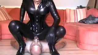 Mistress in hot outfit facesitting submissive male