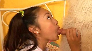 Asian girl gives head to a masked dude and rides his dick
