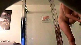 Kinky voyeur captures a desirable brunette taking a shower
