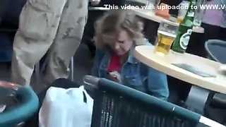 Drunk woman pissing on a bar terrace